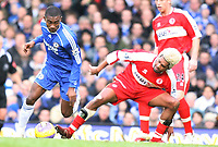 Xavier of Middlesbrough tries to block Diarra of Chelsea