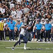 Oct 09 2016 - Oakland U.S. CA - Chargers quarterback Philip Rivers #17 attempt a deep pass to wide receiver Travis Benjamin #12 almost intercepted by Oakland Raiders cornerback Sean Smith #21during the NFL Football game between San Diego Chargers and the Oakland Raiders 34-31 win at O.co Coliseum Stadium Oakland Calif. Thurman James