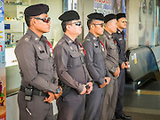 22 MAY 2015 - BANGKOK, THAILAND:    Thai police line up in the Lat Phrao subway stop expecting to confront anti-coup protestors. The Thai military seized power in a coup on May 22, 2014. There were small protests throughout Bangkok Friday to mark the first anniversary of the coup. Police arrested protestors at several locations. The most serious protest was at Bangkok Art and Culture Centre (BACC) where about 100 protestors, mostly students, faced off against police for several hours. Police made numerous arrests at the BACC protest.    PHOTO BY JACK KURTZ