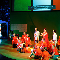 Picture shows : Karen Cargill as Isabella in red dress..Picture  ©  Drew Farrell Tel : 07721 -735041..A new Scottish Opera production of  Rossini's 'The Italian Girl in Algiers' opens at The Theatre Royal Glasgow on Wednesday 21st October 2009..(Soap) opera as you've never seen it before..Tonight on Algiers.....Colin McColl's cheeky take on Rossini's comic opera is a riot of bunny girls, beach balls, and small screen heroes with big screen egos. Set in a TV studio during the filming of popular Latino soap, Algiers, the show pits Rossini's typically playful and lyrical music against the shoreline shenanigans of cast and crew. You'd think the scandal would be confined to the outrageous storylines, but there's as much action off set as there is on.....Italian bass Tiziano Bracci makes his UK debut in the role of Mustafa. Scottish mezzo-soprano Karen Cargill, who the Guardian called a 'bright star' for her performance as Rosina in Scottish Opera's 2007 production of The Barber of Seville, sings Isabella..Cast .Mustafa...Tiziano Bracci.Isabella..Karen Cargill.Lindoro...Thomas Walker.Elvira...Mary O'Sullivan.Zulma...Julia Riley.Haly...Paul Carey Jones.Taddeo...Adrian Powter..Conductors.Wyn Davies.Derek Clarke (Nov 14)..Director by Colin McColl.Set and Lighting Designer by Tony Rabbit.Costume Designer by Nic Smillie..New co-production with New Zealand Opera.Production supported by.The Scottish Opera Syndicate.Sung in Italian with English supertitles..Performances.Theatre Royal, Glasgow - October 21, 25,29,31..Eden Court, Inverness - November 7. .His Majesty's Theatre, Aberdeen  - November 14..Festival Theatre,Edinburgh - November 21, 25, 27 ...Note to Editors:  This image is free to be used editorially in the promotion of Scottish Opera. Without prejudice ALL other licences without prior consent will be deemed a breach of copyright under the 1988. Copyright Design and Patents Act  and will be subject to payment or legal action, where appropriate..Further further inform