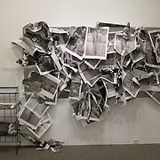 Mira Mexico installation for the 2013 Sondheim Prize Exhibition at The Walter's Art Museum in Baltimore Maryland. Mira Mexico newspapers hung by visitors at the museum in a part of the installation created for interaction with the public with in the gallery space adjacent to Louie's prints.