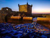 ESSAOUIRA, MOROCCO - CIRCA MAY 2018:  Sunset over the port of Essaouria and the famous Castelo Real of Mogador.