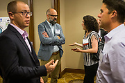 Fergus O'Shea of Facebook and Christina Briggs of City of Fremont talk during the Silicon Valley Business Journal's Future of Fremont event at Fremont Marriott Silicon Valley in Fremont, California, on June 18, 2019.  (Stan Olszewski for Silicon Valley Business Journal)