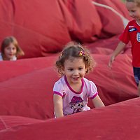 Children play on the balloon to remove hot air from it after landing during the Velence Lake International Hot Air Balloon Festival in Agard, Slovakia on September 10, 2011. ATTILA VOLGYI
