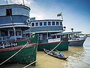 22 OCTOBER 2015 - YANGON, MYANMAR: A boat moored to a river freighter on the Yangon River in Yangon, Myanmar.    PHOTO BY JACK KURTZ