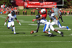 17 September 2016:  Anthony Fowler gets upended by Bradley Dewberry as they both go for a passed ball. NCAA FCS Football game between Eastern Illinois Panthers and Illinois State Redbirds for the 105th Mid-America Classic on Family Dat at Hancock Stadium in Normal IL (Photo by Alan Look)
