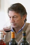 Michel Julien Chateau Villerambert-Julien near Caunes-Minervois. Minervois. Languedoc. Owner winemaker. Tasting wine. France. Europe. Bottle. Wine glass.