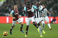 Cheikhou Kouyate of West Ham United and Allan-Romeo Nyom of West Bromwich Albion compete for the ball. Premier league match, West Ham Utd v West Bromwich Albion at the London Stadium, Queen Elizabeth Olympic Park in London on Saturday 11th February 2017.<br /> pic by John Patrick Fletcher, Andrew Orchard sports photography.