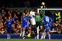 Fotball<br /> England 2004/2005<br /> Foto: BPI/Digitalsport<br /> NORWAY ONLY<br /> <br /> Chelsea v Bolton Wanderers<br /> FA Barclays Premiership. 20/11/2004.<br /> <br /> Chelsea keeper Petr Cech flaps at the cross to allow Kevin Davis to head in.