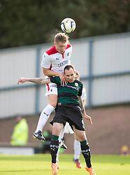 Falkirk's Peter Grant over Raith Rovers Mark Stewart.<br /> Raith Rovers 0 v 0 Falkirk, Scottish Championship game played 27/9/2014 at Raith Rovers Stark Park.