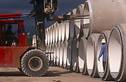 A forklist carefully places concrete moulded pipes at a facility belonging to Hanson, on 17th April 1999, in Dallas, Texas, USA.