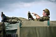 Nederland, Nijmegen, 21-9-2014 Historische militaire legervoertuigen staan bij de Vasim tijdenms de herdenking van de oversteek, de waalcrossing, crossing. Zij rijden de route die de Engelsen aflegden tijdens operatie Market Garden in 1944. Hell's Highway. Herdenking van operatie marketgarden in september 1944. 2e wereldoorlog, legervoertuigen, rijden van Veghel naar Nijmegen. Het is de laatste officiele herdenking met veteranen. Market Garden luidde de bevrijding in van Zuid Nederland. Het veroveren van alle bruggen mislukte. FOTO: FLIP FRANSSEN/ HOLLANDSE HOOGTE