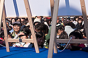 Crowds keep watch on the board announcing the prize numbers after The Ashigara River festival, Kintaro duck-race in Matsuda, Kanagawa, Japan April 25th 2010