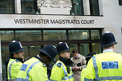 © London News Pictures. 30/05/2013. London, UK.  POlice on guard outsideWestminster magistrates court in London where Michael Adebowale is due to appear after being charged with the murder of soldier Lee Rigby in south-east London last week. A second man accused of murder, Michael Adebolajo, remains under arrest at a London hospital. Photo credit: Ben Cawthra/LNP