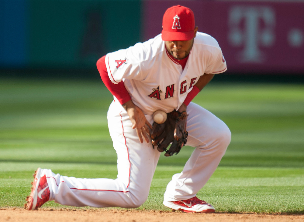 The Angels' Gregorio Petit snags a grounder against the Detroit Tigers Wednesday at Angel Stadium.<br /> <br /> ///ADDITIONAL INFO:   <br /> <br /> angels.0602.kjs  ---  Photo by KEVIN SULLIVAN / Orange County Register  -- 6/1/16<br /> <br /> The Los Angeles Angels take on the Detroit Tigers Wednesay at Angel Stadium.