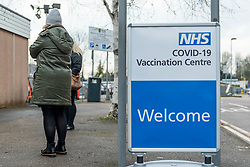 © Licensed to London News Pictures. 11/02/2021. WATFORD, UK. A patient at the entrance to a new Covid-19 vaccine centre at Watford Town Hall.  Watford Borough Council has worked closely with the NHS, to adapt the one level extension to the Town Hall for its new role.  Vaccines are administered on an appointment only basis as the UK government attempts to reach its target of 15 million vaccines administered by 15 February.   Photo credit: Stephen Chung/LNP
