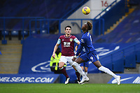 Football - 2020 / 2021 Premier League - Chelsea vs Burnley - Stamford Bridge<br /> <br /> Chelsea's Tammy Abraham holds off the challenge from Burnley's Ashley Westwood.<br /> <br /> COLORSPORT/ASHLEY WESTERN