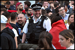 June 16, 2018 - London, London, United Kingdom - Fans Watch England Vs Tunisia from Paddington. Merchant Square...Football fans gather in Merchant Square in London's Paddington to watch England play Tunisia in the World Cup 2018. (Credit Image: © Pete Maclaine/i-Images via ZUMA Press)