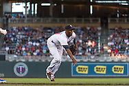 Samuel Deduno #21 of the Minnesota Twins flips the ball to 1st base against the Kansas City Royals on June 27, 2013 at Target Field in Minneapolis, Minnesota.  The Twins defeated the Royals 3 to 1.  Photo by Ben Krause