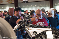 Zach Ness talking with Dave Perewitz about his bike at the Old Iron - Young Blood exhibition media and industry reception in the Motorcycles as Art gallery at the Buffalo Chip during the annual Sturgis Black Hills Motorcycle Rally. Sturgis, SD. USA. Sunday August 6, 2017. Photography ©2017 Michael Lichter.