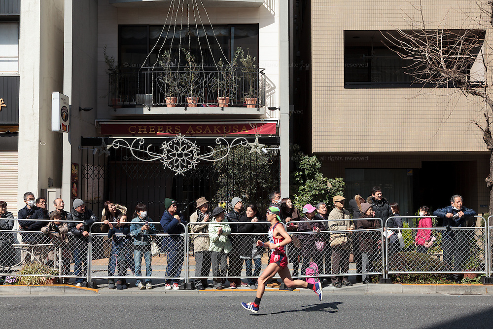 Spectators watch the 10th Tokyo Marathon  on a fine spring day in Asakusa, Tokyo Japan. Sunday February 28th 2016. Thirty-six thousand runners took part with Ethiopian,  Feyisa Lilesa winning the  men's competition and  Kenyan, Helah Kiprop victorious in the women's race.