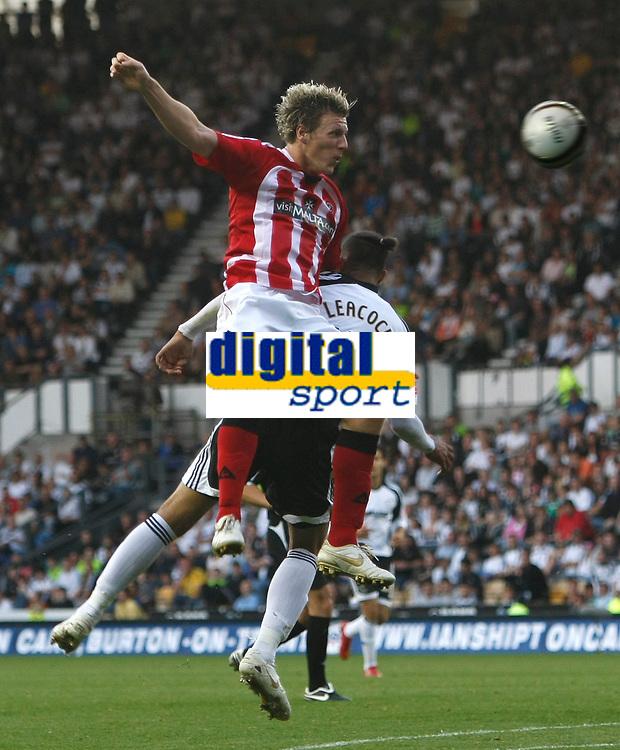 Photo: Steve Bond/Richard Lane Photography. Derby County v Sheffield United. Coca-Cola Championship. 13/09/2008. Darius Henderson (L) gets above Dean Leacock (lower R)