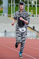 Sheffield Half Marathon Fun Run Sunday Morning.First zebra to cross the line on the fun run..12 May 2013.Image © Paul David Drabble