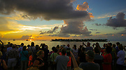 Tourists enjoy a spectacular Sunset from Sunset Pier, Key West Florida [for some strange reason the clap when the sun passes the horizon]