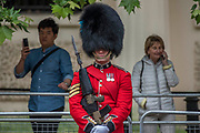 Guards on The Mall - Colonel's Review 2018, the last formal inspection of the Household Division before The Queen's Birthday Parade, more popularly known as Trooping the Colour. The Coldstream Guards Troop Their Colour and their Regimental Colonel, Lieutenant General Sir James Jeffrey Corfield Bucknall, takes the salute.