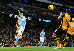 Kevin De Bruyne of Manchester City crosses over Harry Maguire of Hull City  - Mandatory byline: Matt McNulty/JMP - 01/12/2015 - Football - Etihad Stadium - Manchester, England - Manchester City v Hull City - Capital One Cup - Quarter-final
