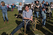 PADDY HOARE, SETTING UP THE LURE PULLING MACHINE FOR THE DOG RACES,  Heythrop Point to Point, Cocklebarrow, 2 April 2017.