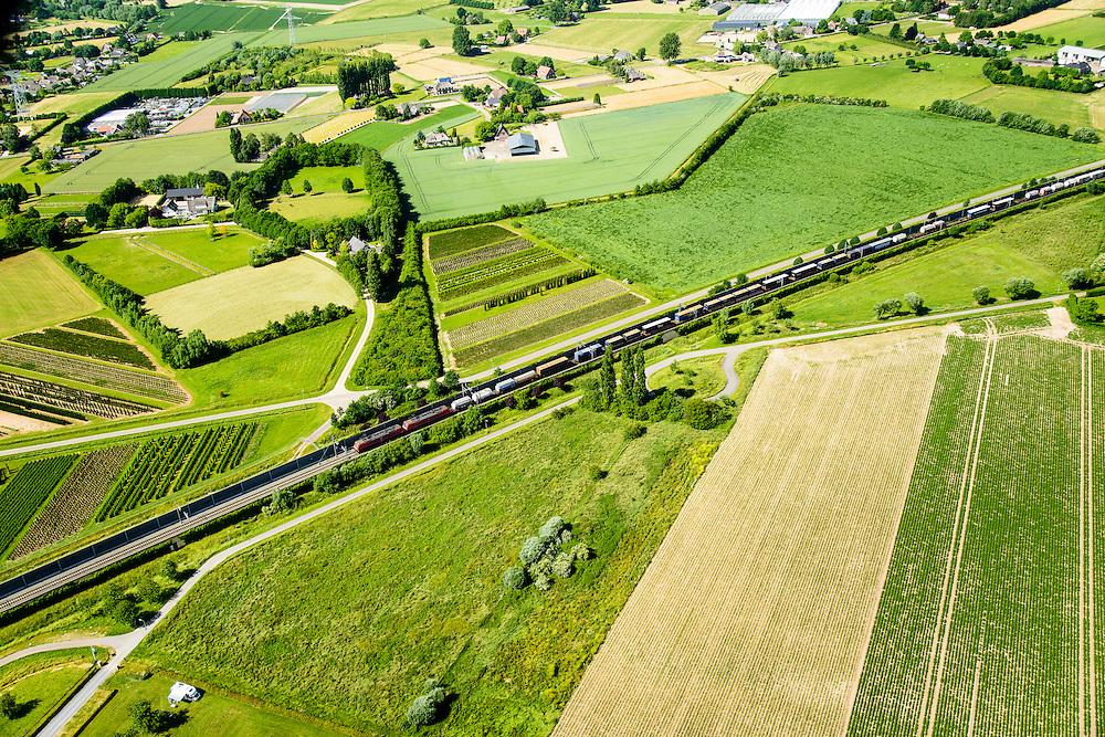 Nederland, Gelderland, Duiven, 09-06-2016; Groessen, natuurgebied Kandia. Goederentrein op Betuweroute nadert de tunnel onder Pannerdens kanaal.<br /> Tunnel Betuweroute, freight railway, Pannerdensch channel (Lower Rhine) on the horizon.<br /> <br /> luchtfoto (toeslag op standard tarieven);<br /> aerial photo (additional fee required);<br /> copyright foto/photo Siebe Swart