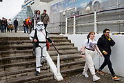 Fans of comic books dressed as their favourite characters attend the first day of MCM Comic Con 2019 at Excel centre on 25th October 2019 in London, England, United Kingdom.