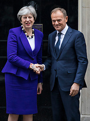 © Licensed to London News Pictures. 01/03/2018. London, UK. Prime Minister Theresa May (L) greets European Council President Donald Tusk (R) on Downing Street. Photo credit: Rob Pinney/LNP