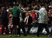 Photo: Javier Garcia/Back Page Images<br />Charlton Athletic v Arsenal, FA Barclays Premiership, The Valley 01/01/2005<br />Alan Curbishley confronts ref Mark Halsey after Freddie Ljungberg's second goal which he felt was offside