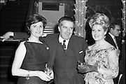 18/04/1962<br /> 04/18/1962<br /> 18 April 1962 <br /> Betty Whelan and Associates Reception at the Gresham Hotel, Dublin. At the event were (l-r): Mrs J. Duggan; Mr Niall Sheridan, (Telifis Eireann) and <br /> Betty Whelan.