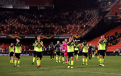 Celtic's players applaud the travelling fans after the match