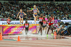 London, August 11 2017 . eventual gold and silver winners Emma Coburn, USA, and Courtney Frerichs, USA, hunt down the leaders in the women's 3000m steeplechase final on day eight of the IAAF London 2017 world Championships at the London Stadium. © Paul Davey.
