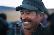 Close portrait of Peruvian male farmer smiling.
