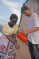 Dan Kammen Helping Woman Wash Her Hands