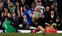 Photo: Daniel Hambury.<br />Chelsea v Liverpool. The Barclays Premiership. 05/02/2006.<br />Chelsea's Arjen Robben is stoped by Liverpool's Steven Gerrard and Jerzy Dudek.