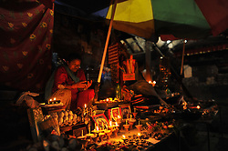 September 7, 2017 - Kathmandu, Nepal - A street vendor selling offering materials around the premises of Basantapur durbar Square on the fifth day of Indra Jatra Festival celebrated in Basantapur Durbar Square, Kathmandu, Nepal on Thursday, September 07, 2017. The huge mask of Swet Bhairab is only open for a week during Indra Jatra festival. Devotees celebrated the god of rain 'Indra' for a week in Kathmandu. (Credit Image: © Narayan Maharjan/Pacific Press via ZUMA Wire)