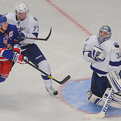 Tampa Bay Lightning goalie Mathieu Garon (32) saves a shot while defenseman Victor Hedman (77) and New York Rangers right wing Ryan Callahan (24) battle in front of the net during second period NHL action between the Tampa Bay Lightning and the New York Rangers at Madison Square Garden.