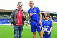 AFC Wimbledon Defender Barry Fuller (2) is presented the winners trophy after the Pre-Season Friendly match between AFC Wimbledon and Watford at the Cherry Red Records Stadium, Kingston, England on 15 July 2017. Photo by Jon Bromley.