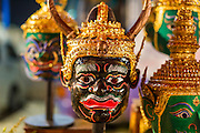 "23 NOVEMBER 2013 - BANGKOK, THAILAND:  Traditional Thai ""Khon Masks"" at a shrine performers pray at before going on stage with the Prathom Bunteung Silp mor lam troupe. Mor Lam is a traditional Lao form of song in Laos and Isan (northeast Thailand). It is sometimes compared to American country music, song usually revolve around unrequited love, mor lam and the complexities of rural life. Mor Lam shows are an important part of festivals and fairs in rural Thailand. Mor lam has become very popular in Isan migrant communities in Bangkok. Once performed by bands and singers, live performances are now spectacles, involving several singers, a dance troupe and comedians. The dancers (or hang khreuang) in particular often wear fancy costumes, and singers go through several costume changes in the course of a performance. Prathom Bunteung Silp is one of the best known Mor Lam troupes in Thailand with more than 250 performers and a total crew of almost 300 people. The troupe has been performing for more 55 years. It forms every August and performs through June then breaks for the rainy season.                   PHOTO BY JACK KURTZ"