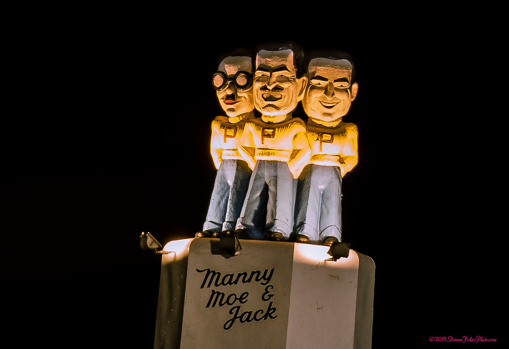 Manny, Moe and Jack atop Pep Boys Auto Supply at MacArthur Road and Grape Streets near Whitehall Mall look out over the night sky. Picture made October, 2019. Donna Fisher Photography, LLC