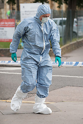 © Licensed to London News Pictures. 21/09/2017. London, UK. A police forensics officer is seen outside a property in Thornton Heath, south London where a 17 year old was arrested last night. This is the sixth arrest in connection with the bombing of an underground train at Parsons Green on September 15th. The bomb failed to fully explode but still injured 30 people. Photo credit: Peter Macdiarmid/LNP