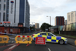 A police roadblock near the Manchester Arena where a suspected terrorist attack at the end of a concert by US star Ariana Grande left 19 dead.