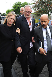 Former England footballer Paul Gascoigne (centre) leaves Dudley Magistrates Court where he has been fined £1,000 for making a racist comment to a black security guard at a public event.