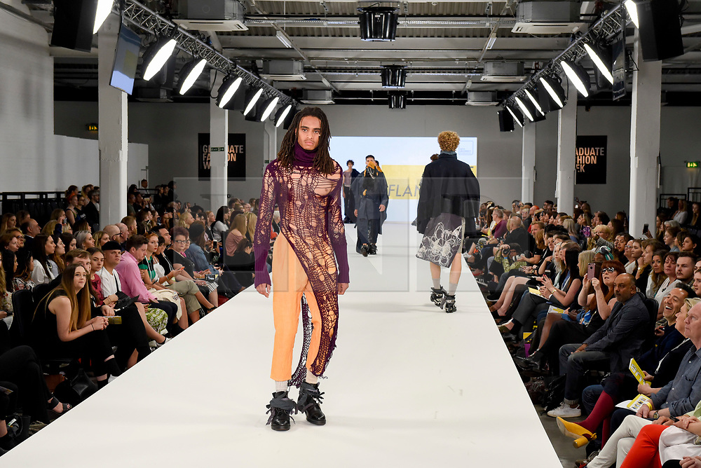 © Licensed to London News Pictures. 05/06/2017. London, UK. A model presents a look by Joe Flanagan from The Arts University Bournemouth on the second day of Graduate Fashion Week taking place at the Old Truman Brewery in East London.  The event showcases the graduation show of up and coming fashion designers from UK and international universities. Photo credit : Stephen Chung/LNP
